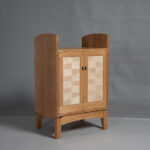 Cabinet with curved sides and two doors