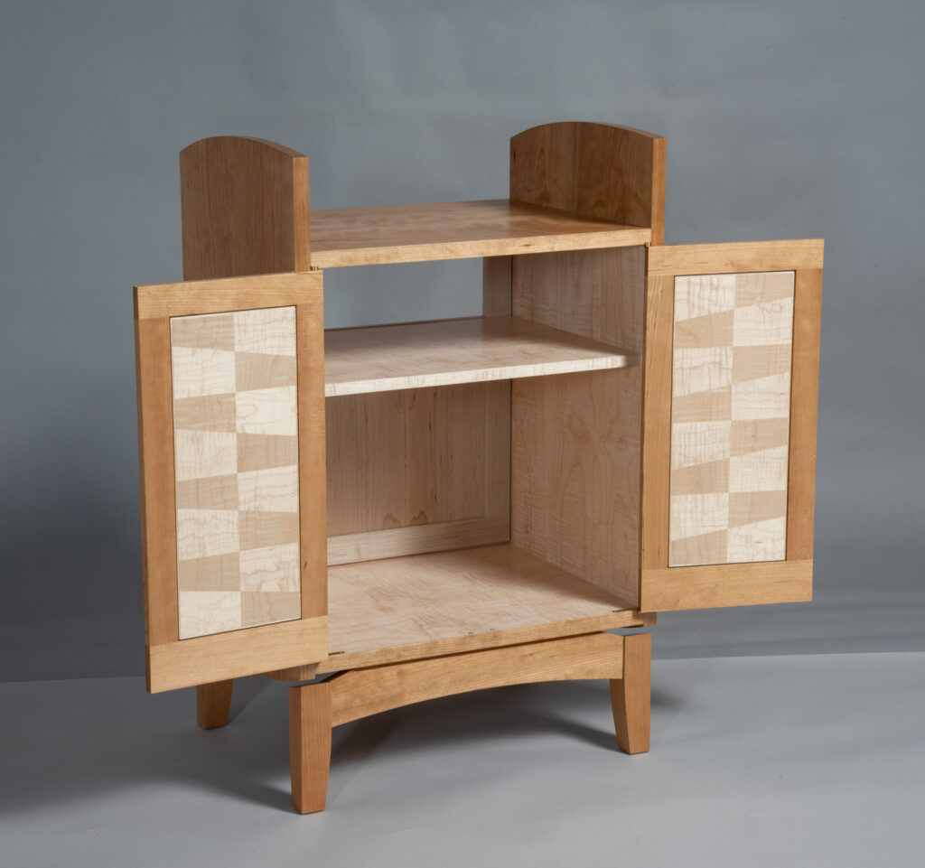 Cabinet with doors open to show interior